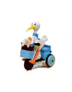 Figura cigüeña en triciclo
